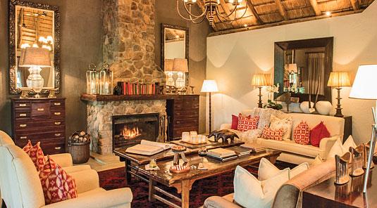 Dulini main lounge with fire place. Dulini Safari Lodge is located in the Sabi Sand Game Reserve