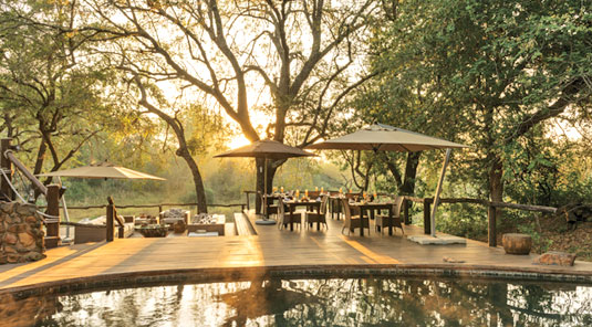 Dulini main deck with Lounge and Dining area. Dulini Safari Lodge is located in the Sabi Sand Game Reserve